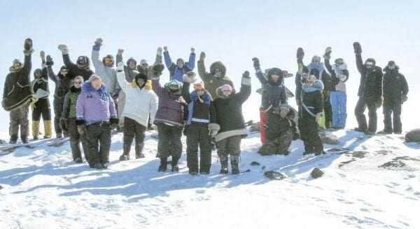 A group of Grade 10 to Grade 12 students from Victor Sammurtok School are enthusiastic about their traditional learning out on the land near Chesterfield Inlet. - photo courtesy of Glen Brocklebank