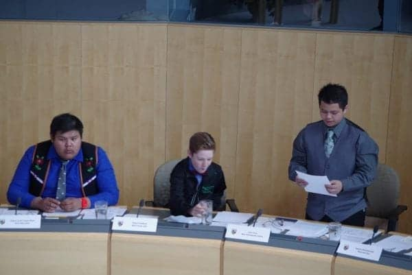 Angus James Capot-Blanc, left, representing Nahendeh and Robert Paddock representing Frame Lake listen as Ivan Ceria, representing Yellowknife Centre, speaks about the problem of homelessness on the streets Yellowknife on Thursday, May 11 at the legislative assembly. Emelie Peacock/NNSL Photo