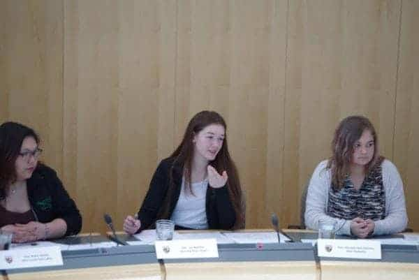 Myha Martin, right, representing Inuvik Twin Lakes, Lisa Boutilier, representing Hay River South, and Macayla Flett-DaCorte, representing Thebacha, during a sitting in the Youth Parliament at the Government of the Northwest Territories legislative assembly on May 11. Boutilier responded to a motion to regulate marijuana across the territory, which passed with 14 votes for, three against and one abstention. Emelie Peacock/NNSL Photo