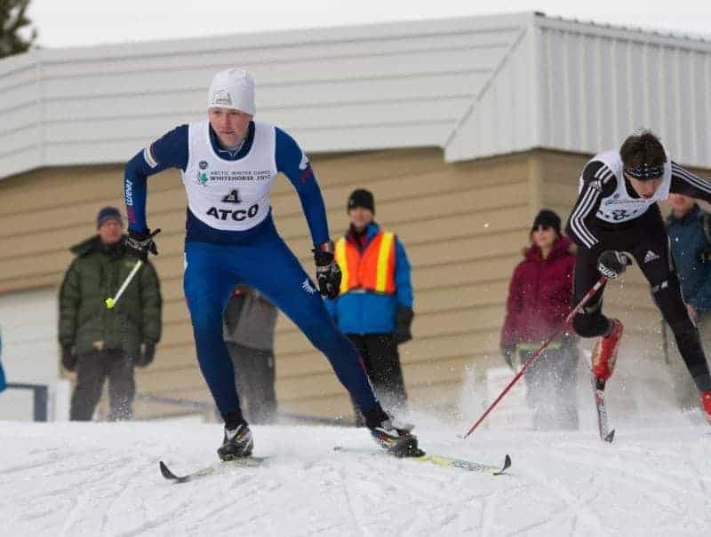 Yellowknife's Oliver Hodgins dodges around a less simble racer during semi-final sprint action at the Mount McIntyre Recreation Center on Tuesday in Whitehorse during the Arctic Winter Games. NNSL File Photo