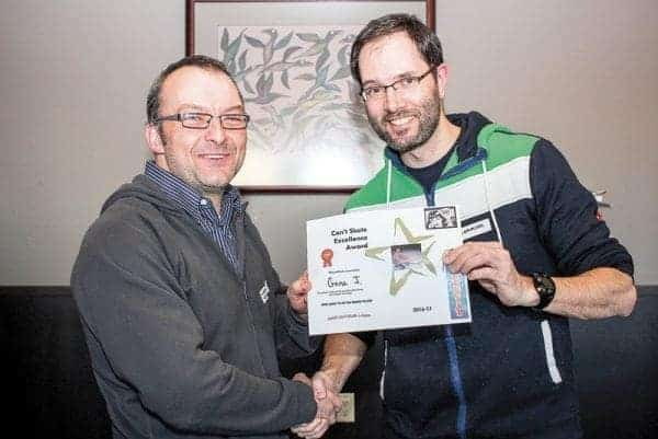 """Mike Harlow, left, presents a Can't Skate Excellence Award to Gene Jenks for """"most likely to hit the boards to stop."""" The Inuvik Can't Skate League held a year-end awards night Friday, April 21. - Stewart Burnett/NNSL photo"""