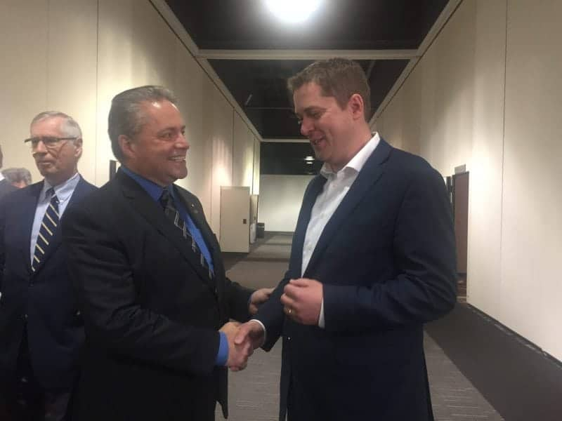 May 28/17 Photo courtesy of David Connelly Yellowknife resident David Connelly, a national vice president of the Conservative Party of Canada and the NWT's representative on the party's national council extends an invitation to new party leader Andrew Sheer to visit the territories. The handshake and offer came Sunday in Toronto, just hours after Scheer had won the party's leadership race.