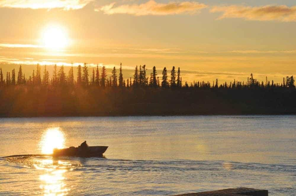 A boater enjoys a few more moments on the Yellowknife River as he prepares to dock during a beautiful sunset at the boat launch. NNSL file photo