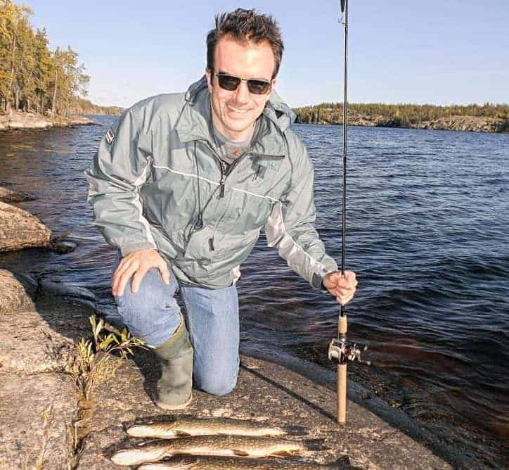Rohan Brown shows off his limit of northern pike caught during an afternoon of fishing at Grace Lake on Sunday. Grace Lake, although subject to recent residential development around its shore, remains one of the cleaner lakes within Yellowknife city limits. Mike Bryant/NNSL photo