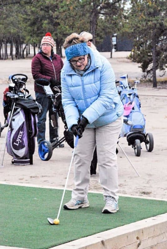 Jeanette King sets up for her tee shot on the 10 th tee during the final Ladies Night of the season at the Yellowknife Golf Club on Wednesday. James McCarthy/NNSL photo