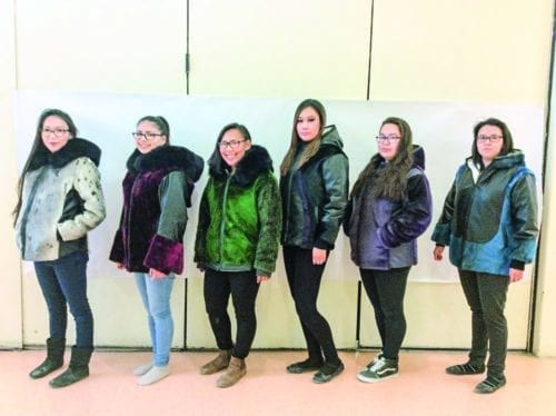 Among the female Grade 12 graduates who made their own sealskin jackets in a special program at Sakku School are, from left, Kayleen Emiktowt, Shantea Bruce, Christa Emiktowt, Krissy Harron, Devonna Ell and Shania Eetuk in Coral Harbour on Sept. 10, 2018. Missing from photo is Linda Ningeongan. Photo courtesy Rhoda Paliak-Angootealuk