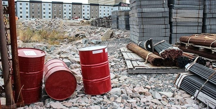 Barrels labeled as containing hazardous chemicals and materials tagged for shipment to Snap Lake Mine sit on the lot in front of Chateau Nova on Highway 3. NNSL file photo.