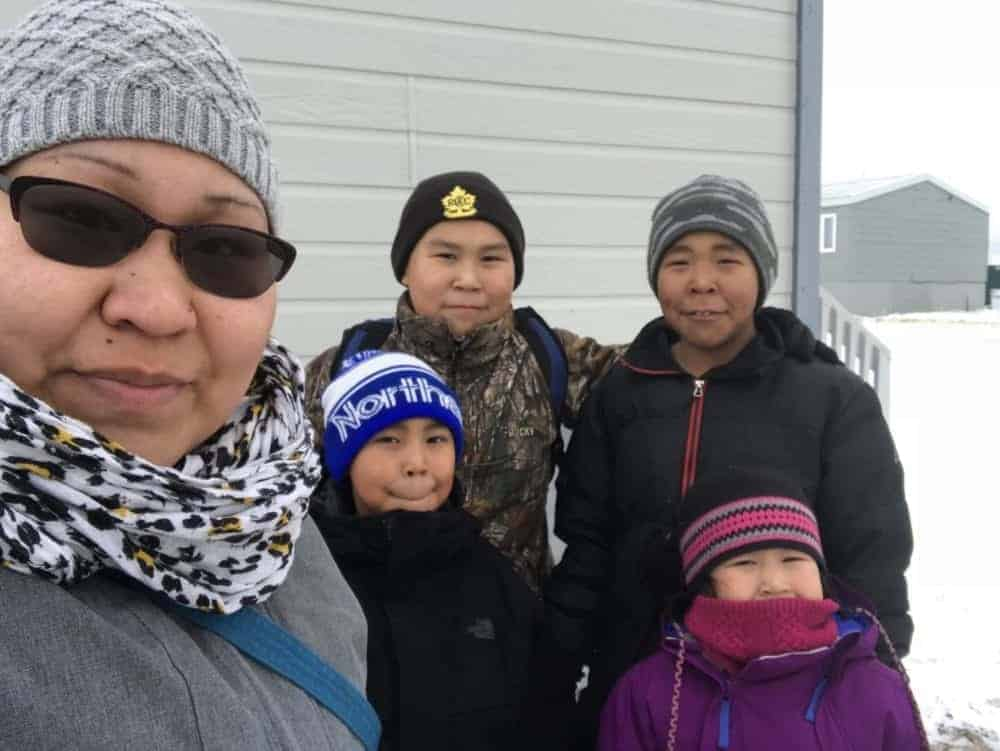 Cambridge Bay's Suzanne Maniyogina and her four children don't have a vehicle. They were expecting their truck, ordered from Hay River, NWT, to arrive by sealift. Now it's not clear whether it will be shipped by air as the last barge to Cambridge Bay was cancelled. Her children are Tayten and Jeremiah, back, and Graysen and Azalea, front. photo courtesy of Suzanne Maniyogina