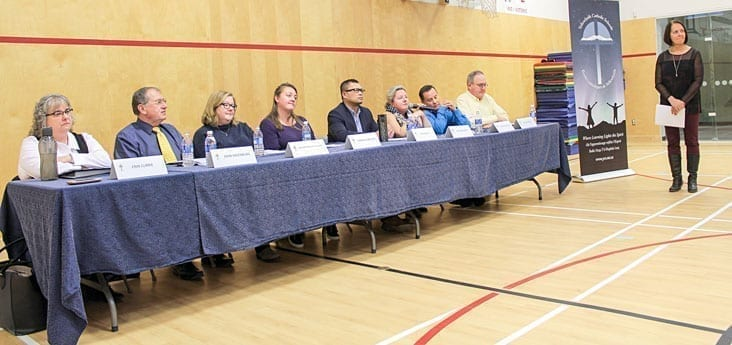 Two of the three newcomers running for the Yellowknife Catholic school board were elected, along with five incumbents. An election forum was held at St. Joseph School, Oct. 10. From left are Erin Currie (elected), John Hazenburg, Lori Macmillan Gallant (elected), Candace Meadus (elected), Revi Lau-a (elected), Tina Schauerte (elected), Steven Voytilla (elected), and Miles Welsh (elected). At far right is moderator and YCS superintendent Claudia Parker. Simon Whitehouse/NNSL photo.