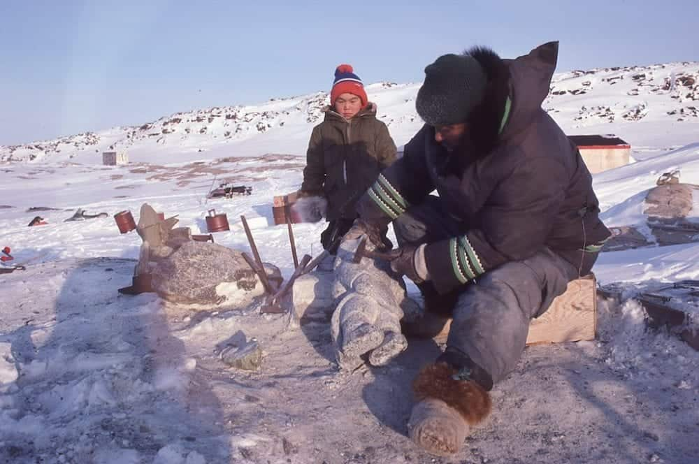 This photo of Kaka Ashoona working on a carving, taken by Cape Dorset photographer Jimmy Manning, is one of many images and written records that will be entered into a digital archive over the next year. The Inuit Art Foundation is behind the initiative. Jimmy Manning photo