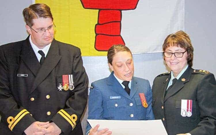 Capt. Erin McKinlay reads a certificate of accomplishment to outgoing 3019 RCACC Commanding Officer 2nd Lieut. Dorothy Tootoo, right, as incoming 3019 Commanding Officer Lieut. Matt Ayres looks on in a change-of-command ceremony in Rankin Inlet on Nov. 23, 2017. NNSL file photo