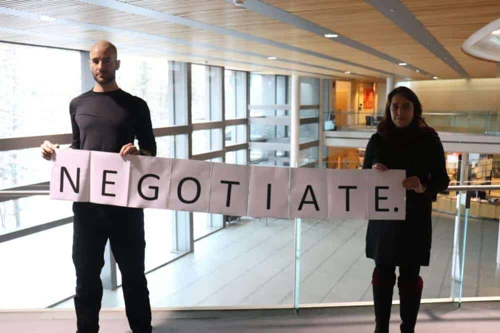 Dylan Short/NNSL photo Clement-Eric Demers, left and Carole Monnet display the sign they held up in the public gallery.