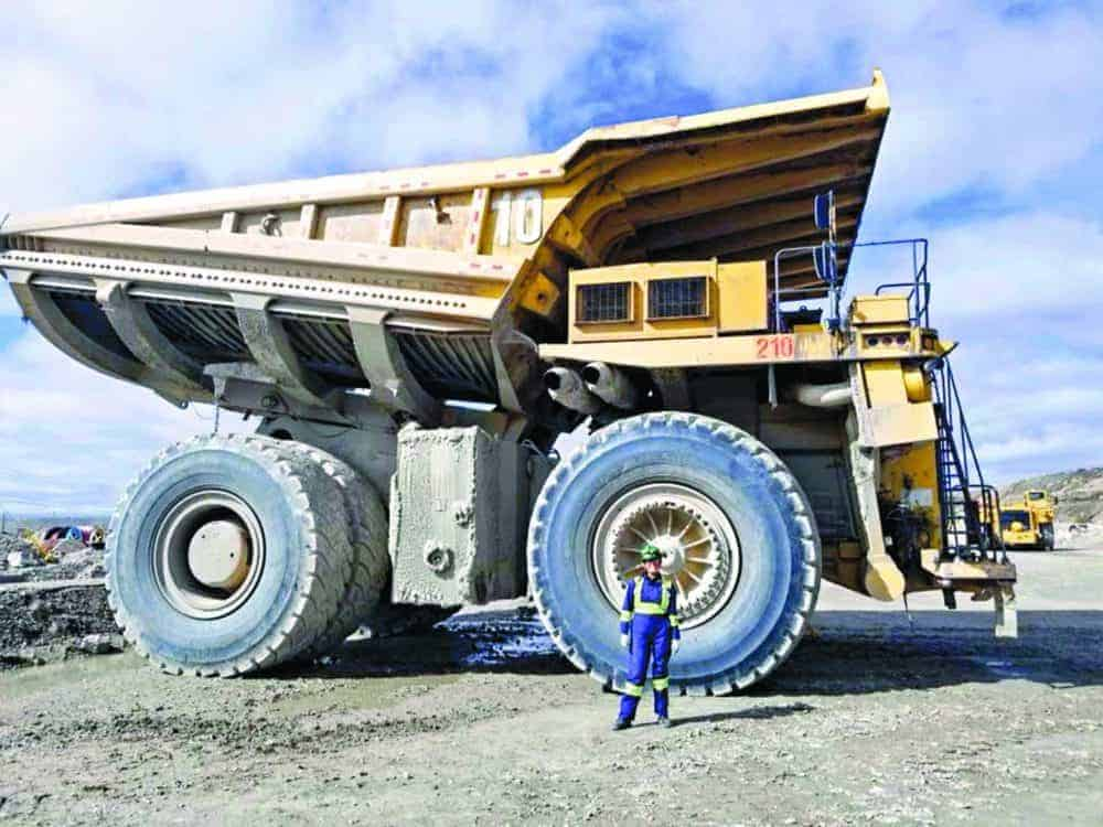 "Britney Nadli, despite posing with a haul truck, works in the process plant at the Diavik diamond mine. ""The job that I'm doing now in the process plant was way beyond my expectations of where I thought to see myself,"" she says. photo courtesy of Diavik Diamond Mines"