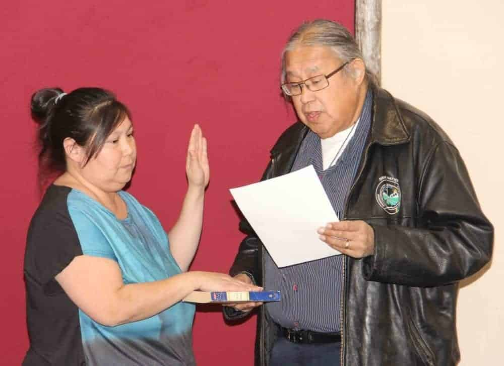 April Martel, left, is sworn in Nov. 7 as the new chief of K'atlodeeche First Nation by outgoing Chief Roy Fabian. Paul Bickford/NNSL photo