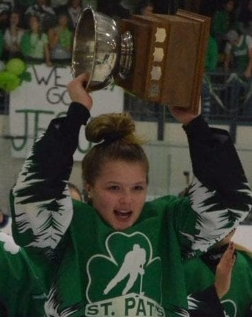 Danae Lafferty of St. Pat's hoists the Wade Hamer Challenge Cup's girls trophy aloft after the Irish defeated Sir John Franklin in the girls game one year ago. NNSL file photo