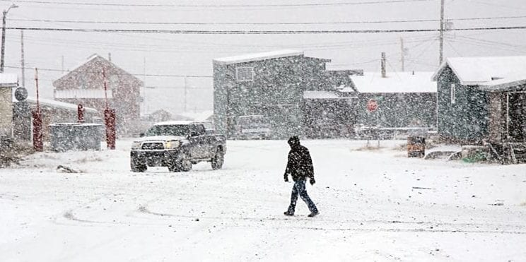 A pedestrian crosses a snowy intersection in Rankin Inlet. Rankin's recent cold snap set a number of recordr low temperatures. NNSL file photo