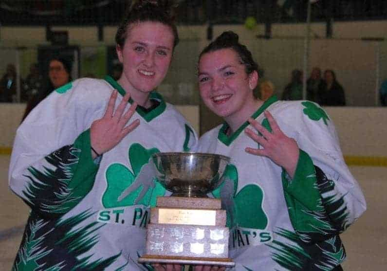 Sarah Fleming, left, captain of the St. Pat's girls team, and Katie Hart are all smilles as they show off how many times they've won the Wade Hamer Challenge Cup girls title as teammates – four – after they won the girls game on Wednesday over Sir John Franklin at the Multiplex. James McCarthy/NNSL photo
