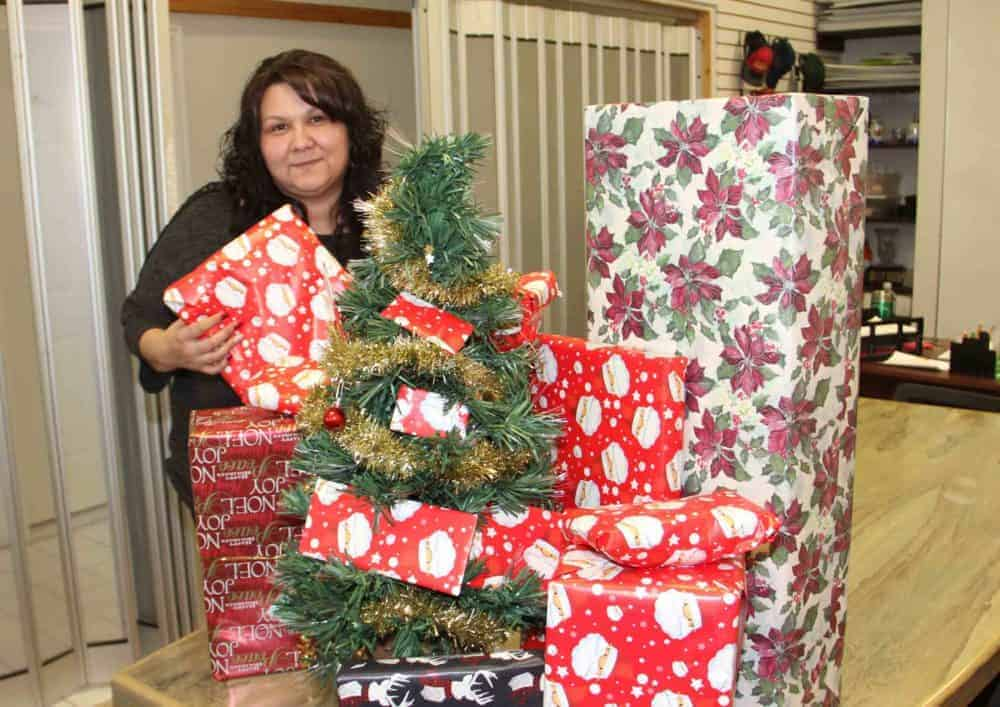 Jacqueline Boyce, the executive assistant with the Hay River Chamber of Commerce, displays some of the prizes in the organization's new Christmas contest called Santa's Sleigh of Surprises. Paul Bickford/NNSL photo