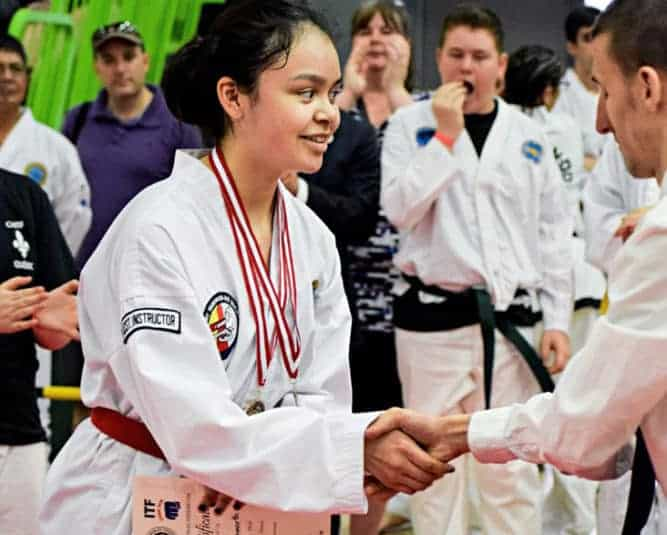 Jennifer Ellsworth is seen at an event earlier this year receiving an award. Ellsworth is one of the newest black belts at the Iqaluit Taekwondo Society. NNSL file photo
