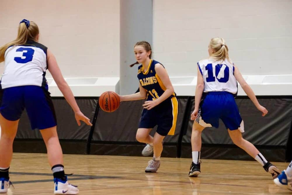 Taya Straker moves the ball up the court during Wolves classic action last week. photo courtesy of Benji Straker photography