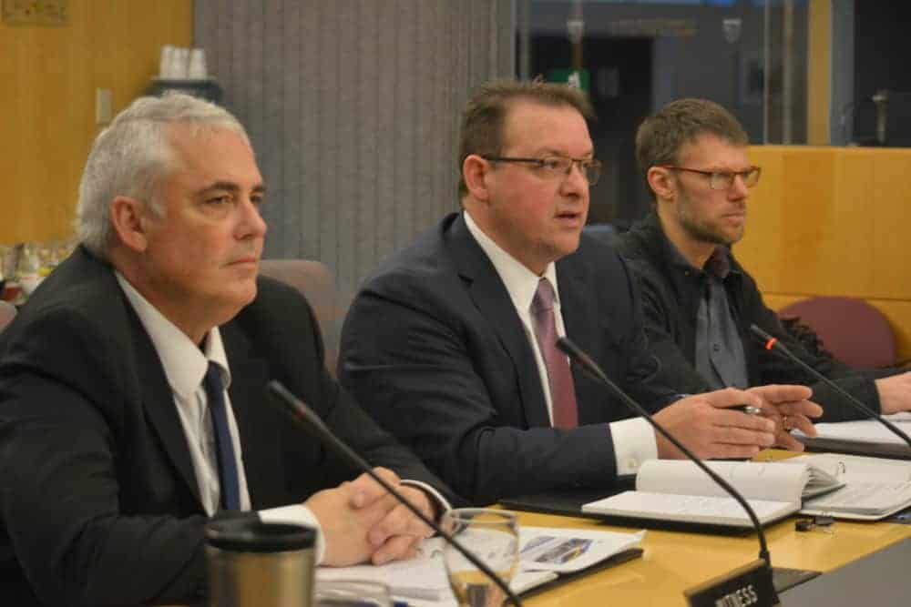 Environment and Natural Resources wildlife director Dr. Brett Elkin and Deputy Minister Joe Dragon present range plans for boreal and Bathurst caribou at a Dec. 7 committee meeting in Yellowknife.