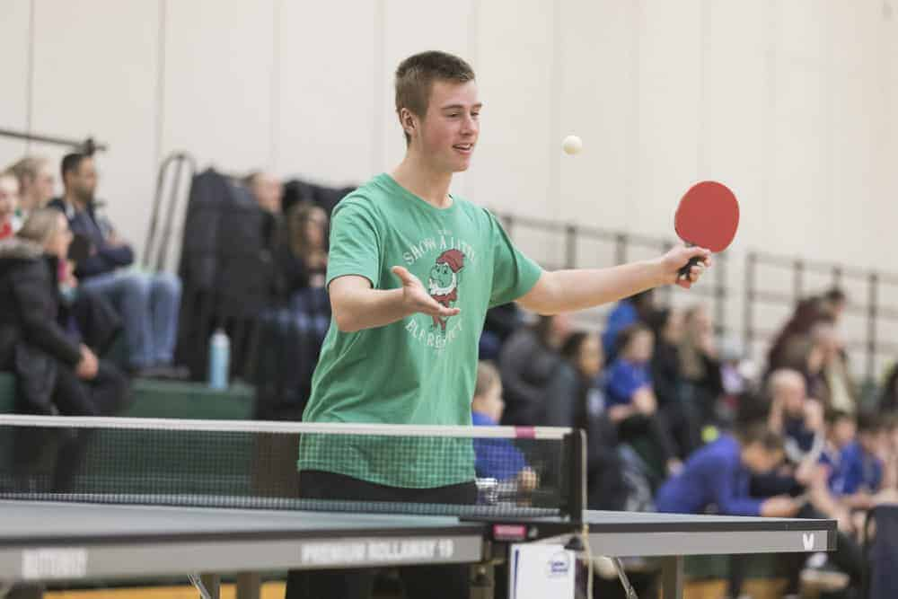 Nathan Cluff serves the ball during men's singles action at the NWT School Championships. photo courtesy of Thorsten Ghol