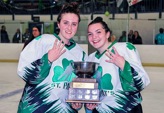Sarah Fleming, left, and Katie Hart, seen celebrating victory at the Wade Hamer Challenge Cup in November, will be part of the girls hockey team at the Canada Winter Games in Red Deer, Alta., next month. NNSL file photo