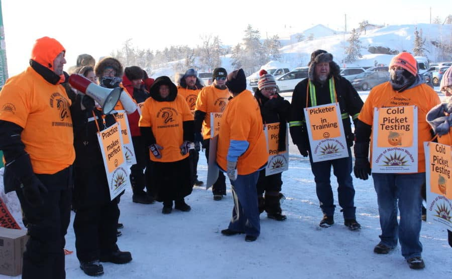 Group of UWN supporters and members and supporters gather outside of North Slave Corrections for a practice picket. Local 11 president Frank Walsh speaks over the megaphone.