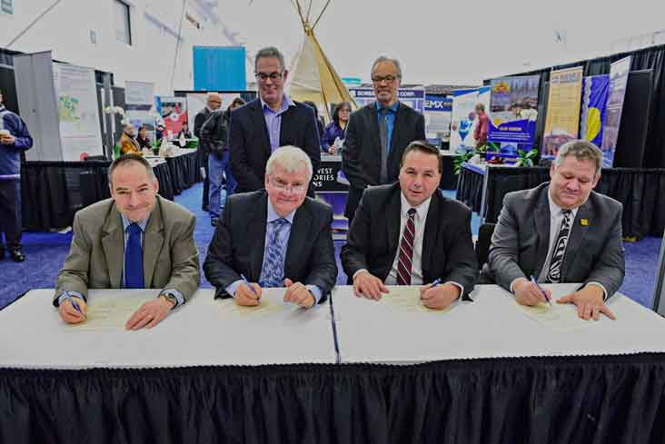 photo courtesy of Ryan McLeod Industry, Tourism and Investment Minister and Health Minister Glen Abernethy sign a socioeconomic agreement with Fortune Minerals, proponents of the NICO project outside of Whati.
