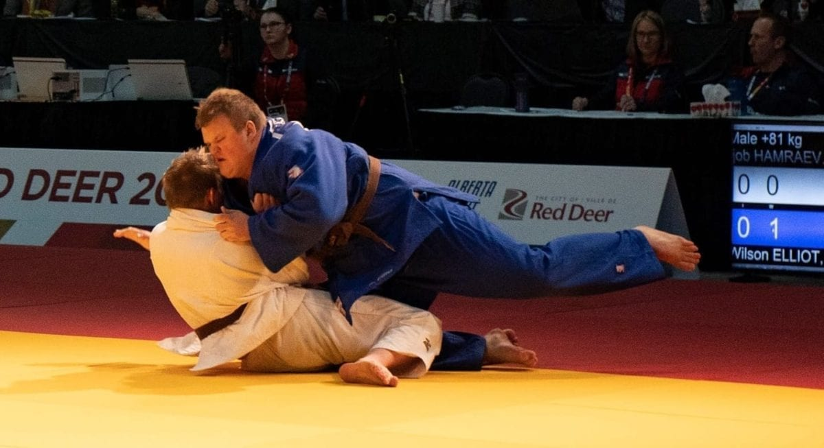 Wilson Elliot, in blue, gets the upper hand on Ijob Hamraev of Manitoba during the bronze medal match in the boys 81-kg judo competition at the Canada Winter Games in Red Deer, Alta., on Wednesday. Sarah Pruys/Team NT photo