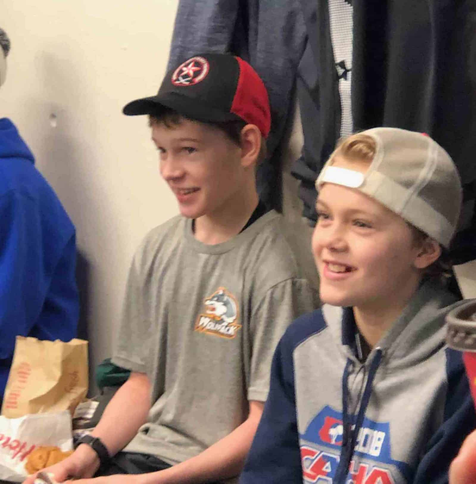 Ryder Wicks, left, and Brayden Hickling of the California Wave share a laugh before suiting up as teammates for the D event final of the Vernon Winter Carnival Coca-Cola Classic Tournament in Vernon, B.C., on Feb. 10. photo courtesy of Darren Wicks