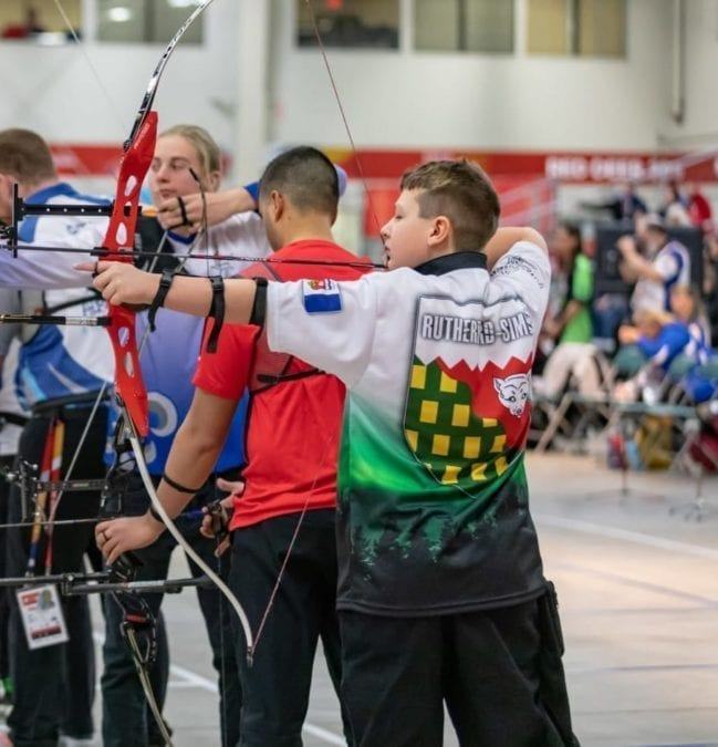 Ferghus Rutherford-Simon of Fort Smith takes aim at the target during action in the male recurve event in archery at the Canada Winter Games in Red Deer, Alta., on Tuesday. Peter Fuzessery/Canada Winter Games photo