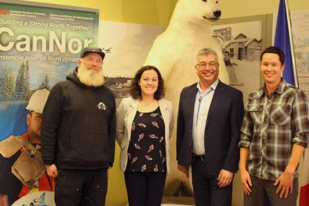 From the left, Snowking (Anthoiny Foliot), Mayor Rebecca Alty, MP Micheal McLeod and owner of Jackpine Paddle Adam Wong gather at the Visitor's Centre to announce $250,000 in funding toward three tourism initiatives in Yellowknife. Brett McGarry / NNSL Photo