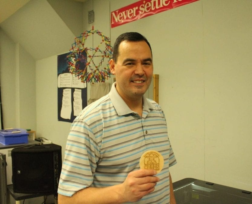 Brett McGarry/ NNSL Photo Assistant Principal at Range Lake North Darryl Mitchener shows off an engraved coaster made with the schools latest addition to their tech room, a laser cutter.