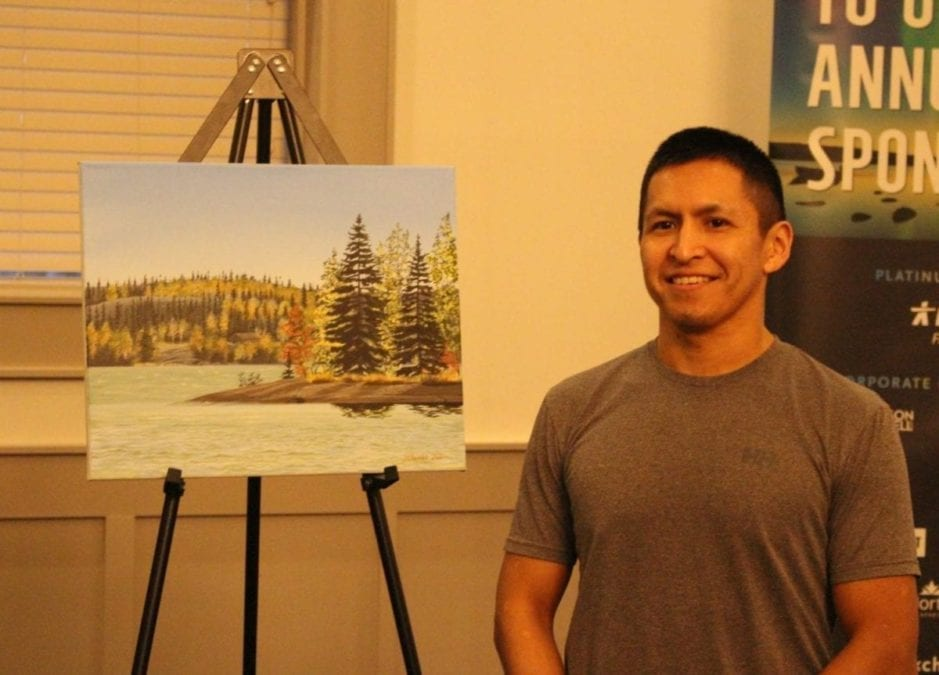 Brett McGarry/NNSL photo. Darrell Chocolate, a local artist was selected to be on the cover of the NorthwesTel phone book. Chocolate painted a landscape of Great Slave lake in the fall.