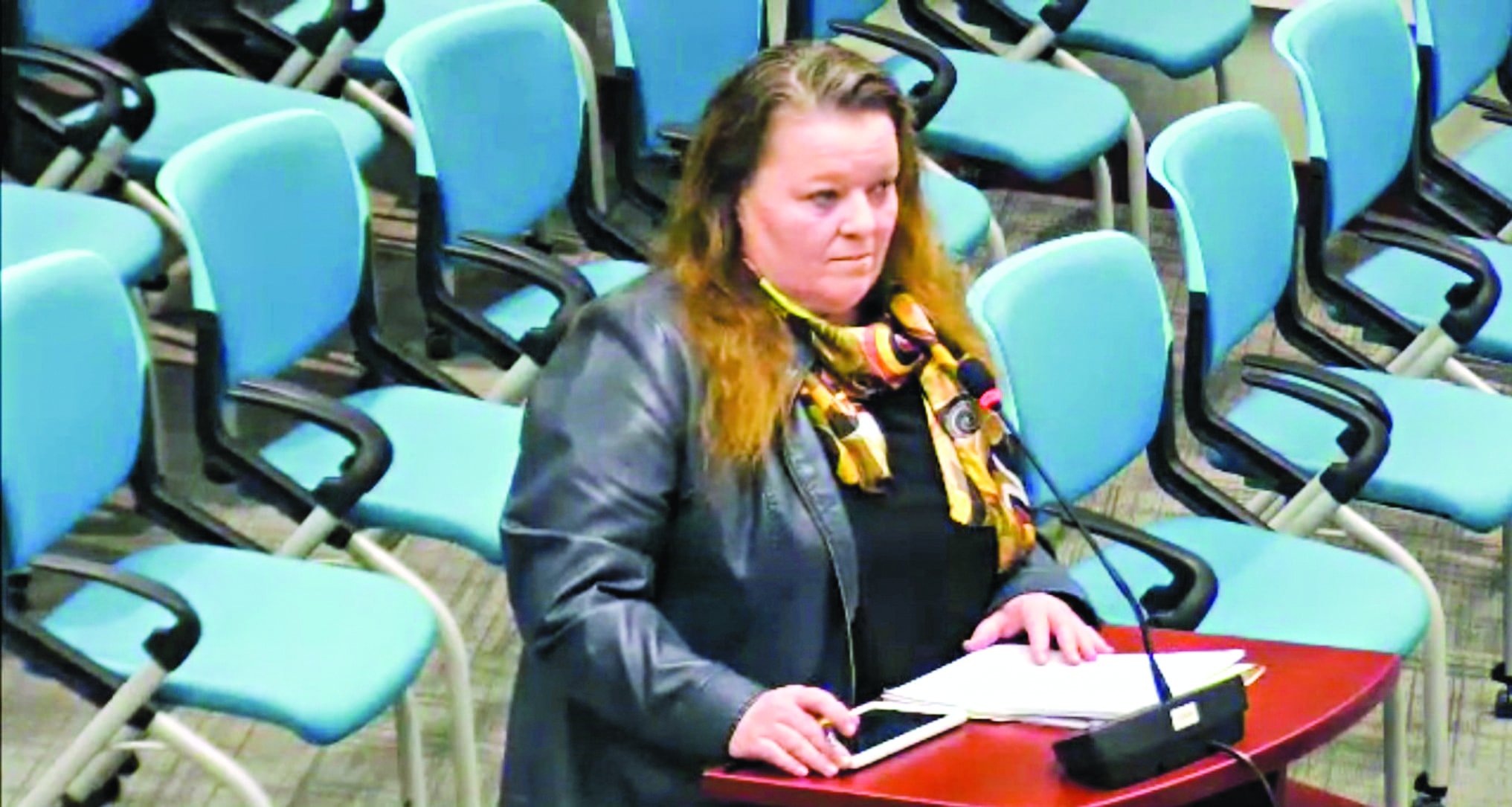 Meda Shanahan stands before city council on March 11 to ask for special permission to use electronic soft meters, as to avoid installing city mandated mechanical fare meters so their new cab company can open on time. Photo courtesy of the City of Yellowknife