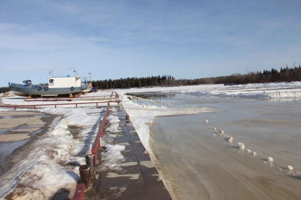 By March 18 - when the temperature hit 13 degrees - the ice on the Hay River in front of Fisherman's Wharf was obviously in no condition for pond hockey. Paul Bickford/NNSL photo