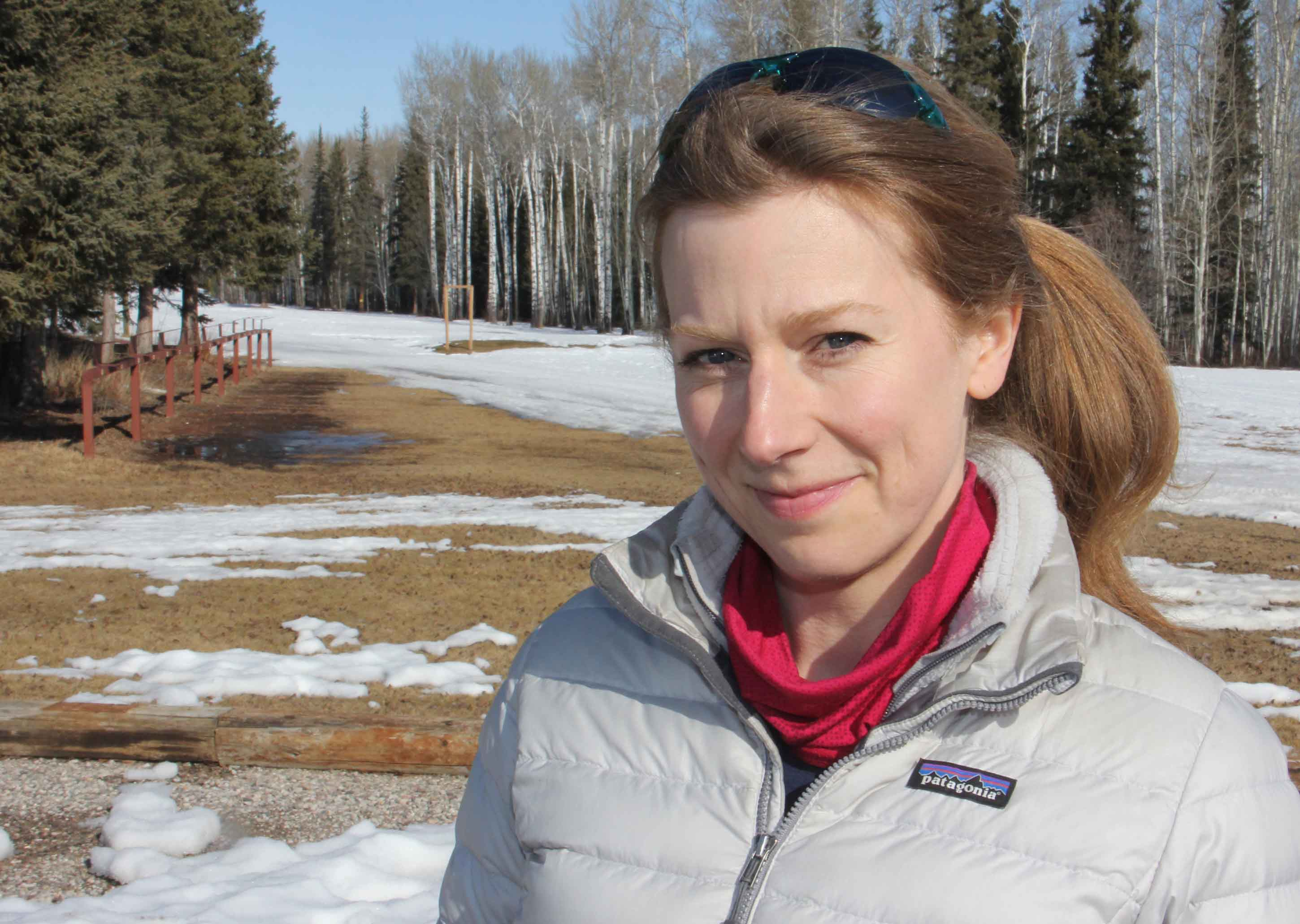 On March 24, Kathleen Groenewegen, the president of the Hay River Ski Club, stands in front of bare ground that would normally be completely covered by snow at this time of year. Paul Bickford/NNSL photo