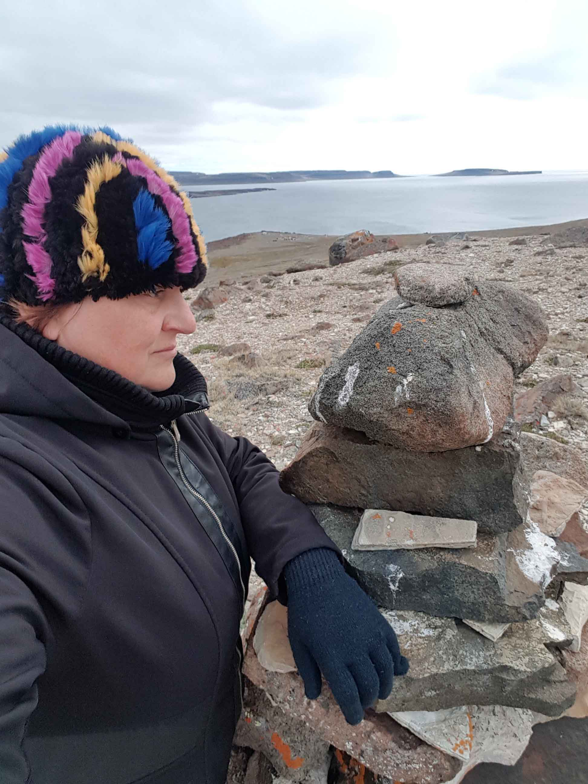 Hay River's April Glaicar explores the hills above Ulukhaktok on Victoria Island in July 2017 during phase one of her art project called 'Our True North', which features Ulukhaktok and Sachs Harbour. The results of that project - photos and glass art - will be presented to residents of Hay River on May 6. Photo courtesy of April Glaicar