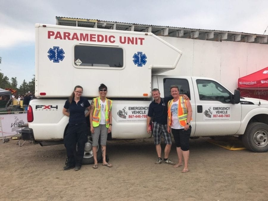 Matt Vincent often donates supplies, medics and vehicles to various events around Yellowknife, as seen here at Folk on the Rocks 2018. From the left, Geraldine Maloney (EMT) Betty Anne Nickerson (EMR) Matt Vincent (Ceo/EMT-P) Carolyn Ridgley (RN BN). Courtesy of Matt Vincent