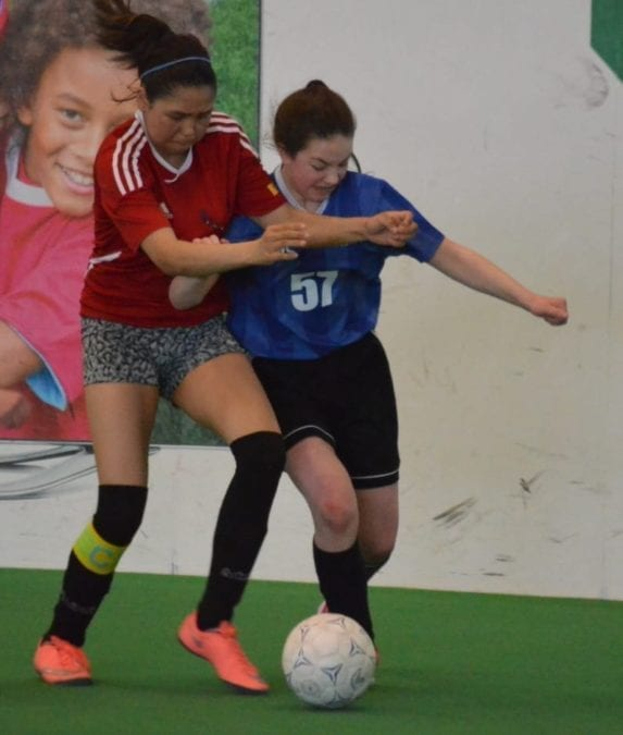 Sophia Barichello of William McDonald, right, does battle with Rankin Inlet's Erin Kaludjak for possession during the Grade 8 girls final of Junior Super Soccer at the Fieldhouse on Sunday. James McCarthy/NNSL photo
