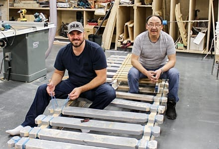 Tuugaalik High School principal Aubrey Bolt stands with some of the supplies and expedition sleds that have been sent to the school in preparation for an Arctic expedition, with a Scottish documentary crew, that hopes to recreate John Rae's expedition. Department of Education photo