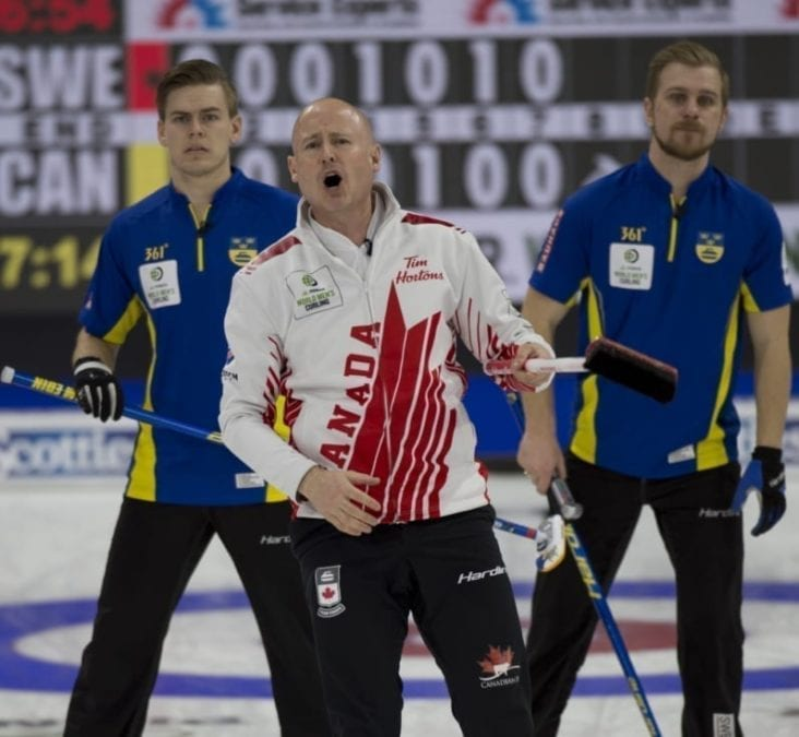 Kevin Koe grimaces as he watches a shot while Sweden's Christoffer Sundgren, left, and Rasmus Wrana look on behind during the final of the World Men's Curling Championship in Lethbridge, Alta., on Sunday evening. Michael Burns/World Curling Federation photo
