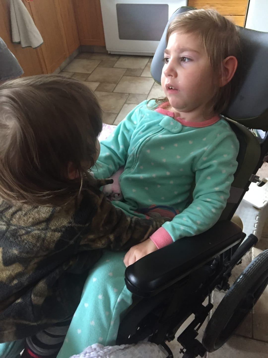 Mikaela MacNaughton had severe strokes at birth which has left her with quadriplegic cerebral palsy, blindness, seizures and multiple other ailments. Her stiff legs have caused her hip to dislocate which means she will need specialized surgery in Texas. Courtesy of Ruth MacNaughton