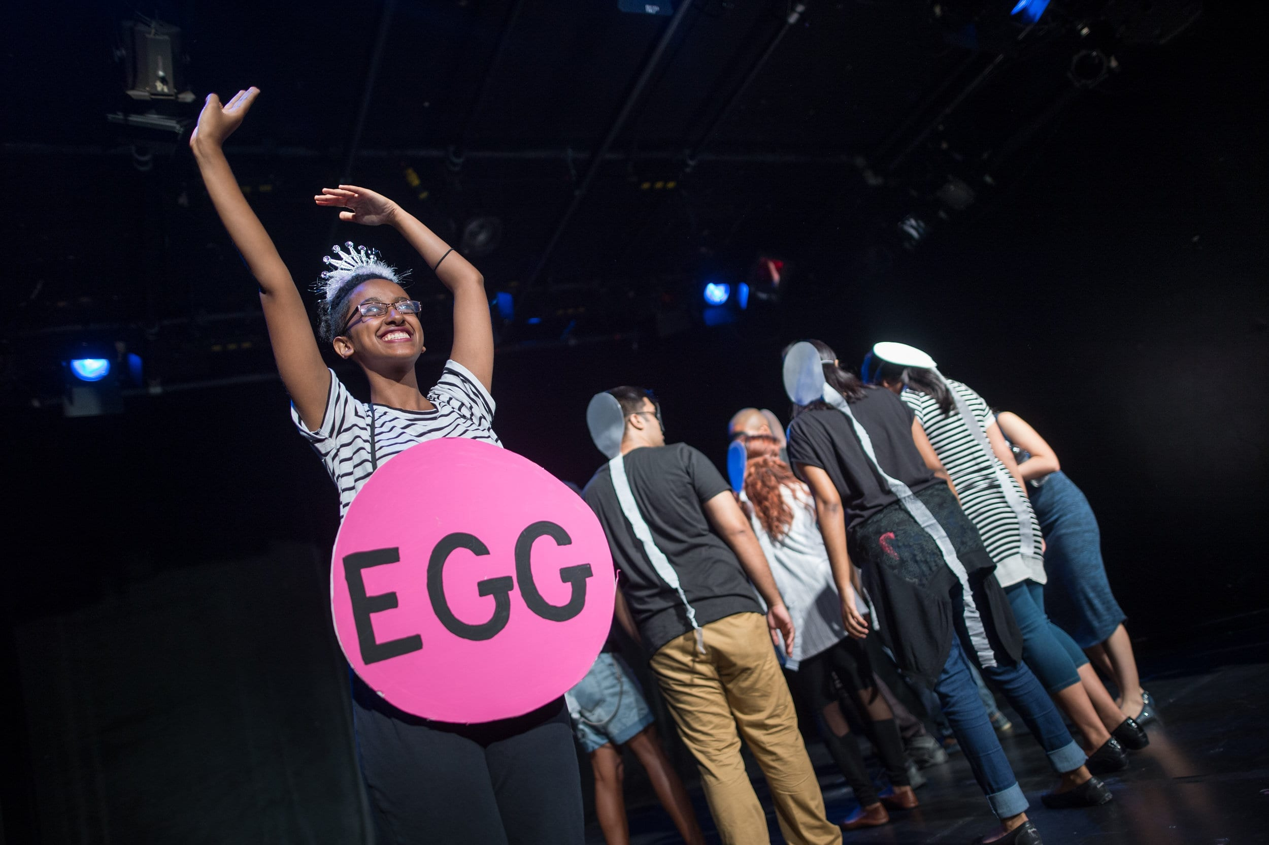 "Mary Getachew and the Cast of SExT performing the scene ""Fertilization Games""; a parody of the 'Hunger Games' where sperm compete in a dance battle to fertilize the egg. photo courtesy of Dahlia Katz"
