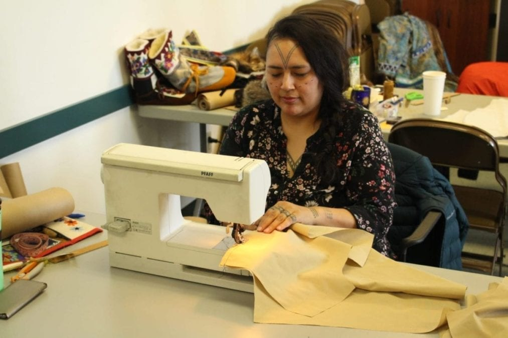 Hovak Johnston using a sewing machine as she starts to piece together what will become a seal skin vest. Working mostly with traditional methods, she said learning modern techniques has been a great asset. Brett McGarry NNSL photo.