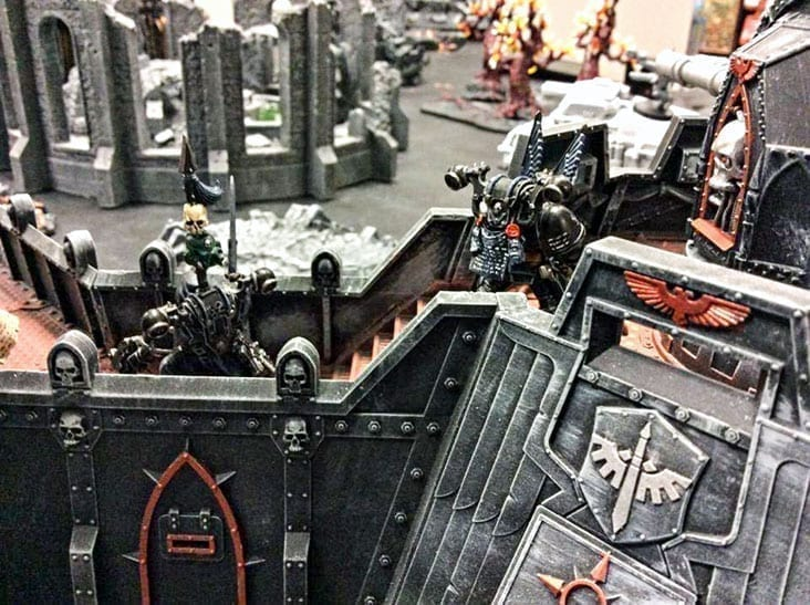 James Croizier shows off fully painted Warhammer 40k miniatures in action. It's one of several tabletop games he has at his downtown shop. Photo courtesy of James Croizier.