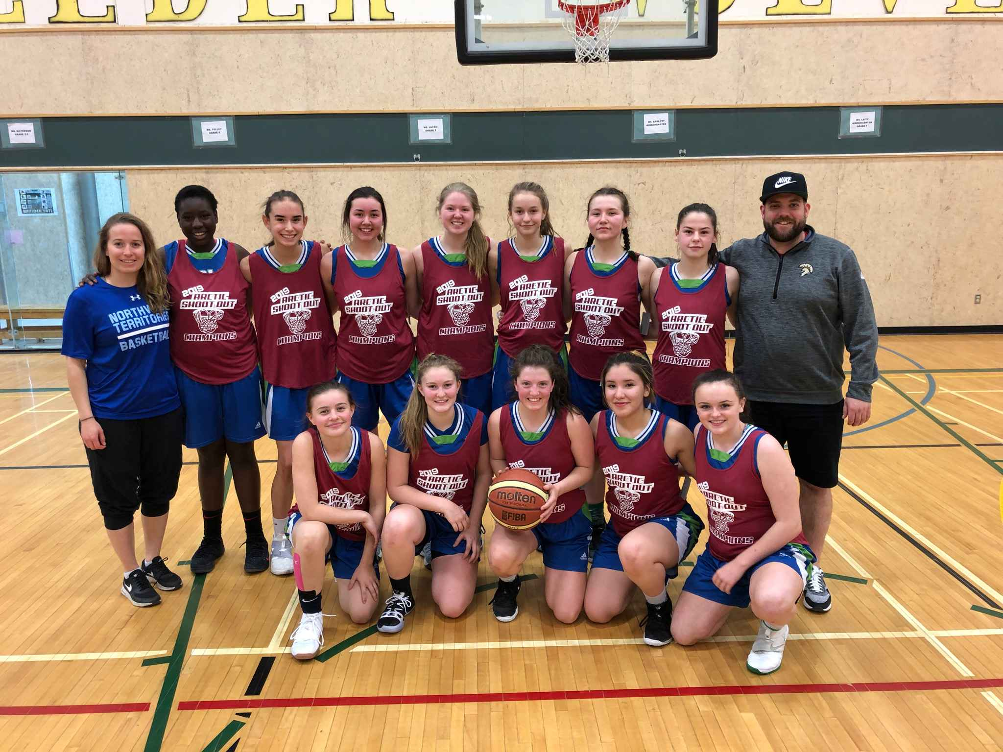 The Deton Cho Eagles are your women's Arctic Shoot-Out champions after beating the Funky Bunch in the final on Sunday at Weledeh Gymnasium. They are, front row from left, Lily Newberry, Mali Straker, Mia MacInnis, Naomi Yukon and Kaitlyn Kenny; back row from left, assistant coach Claire Mennell, Jordan Muchenje, Elle Mitchener, Meadow Munroe, Emma Willoughby, Taya Straker, Lili Casaway, Drew Wolfe and head coach Aaron Wells. photo courtesy of Cole Marshall