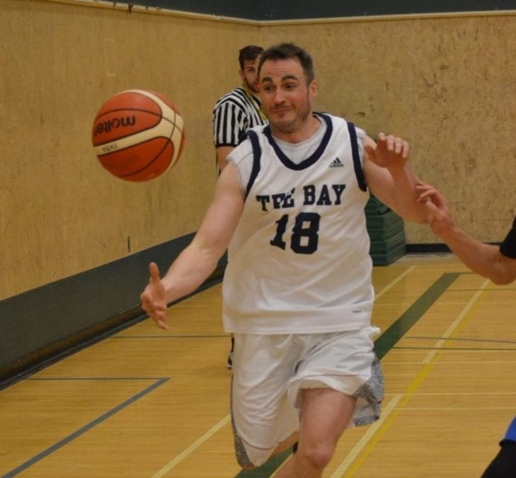 Travis Schindel, playing with The Bay from Cambridge Bay, tries to keep the ball inbounds during the men's final of the Arctic Shoot-Out basketball tournament at St. Pat's Gymnasium on Sunday. James McCarthy/NNSL photo