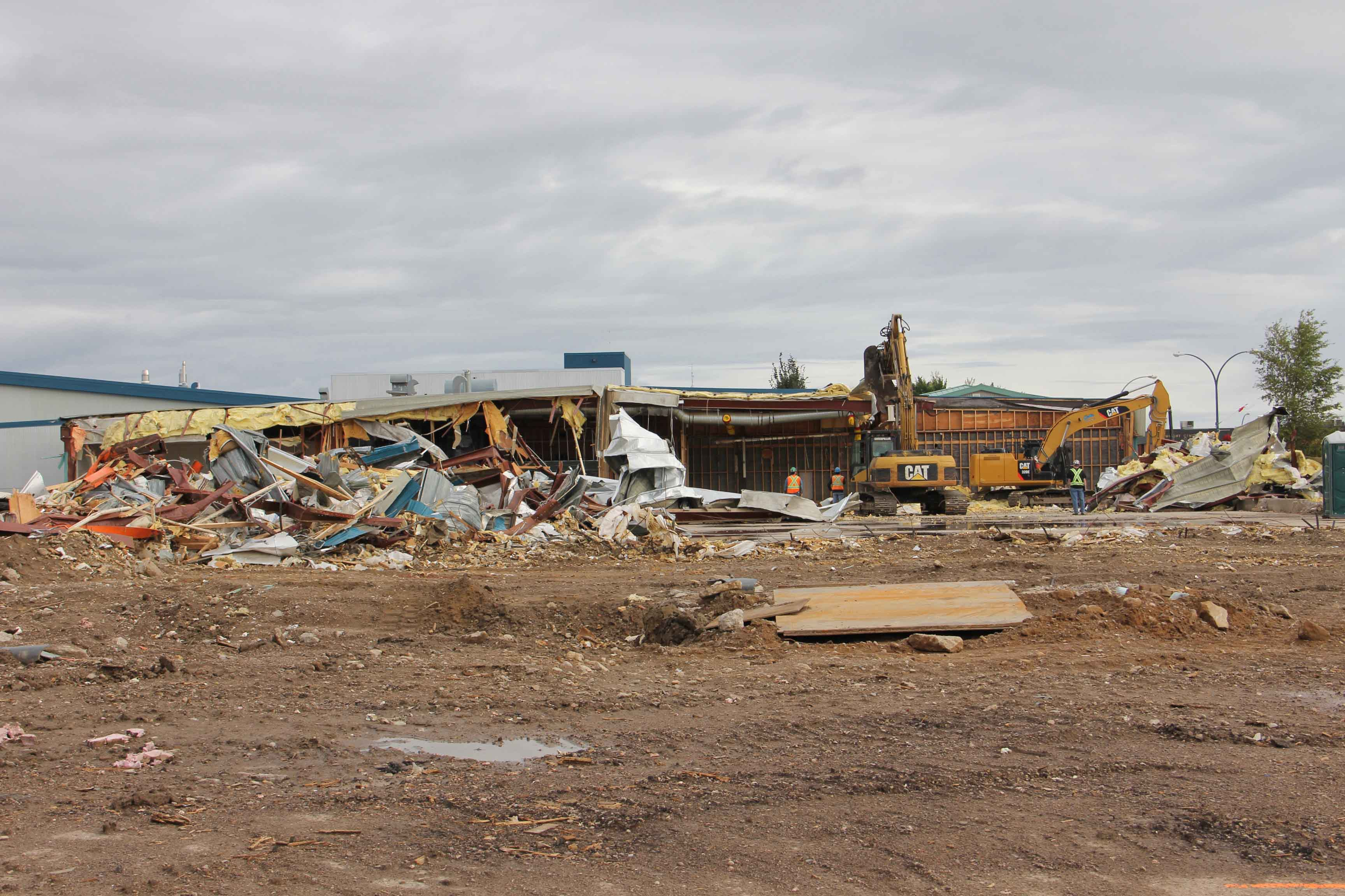 Decades from now, this scene from 2016 - the demolition of the old Rec Centre - may repeat itself in Hay River, and town council is planning ahead to pay for replacing the still-new Rec Centre. NNSL file photo